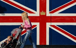 British flag (Union Jack), young girl and a kid in a pram
